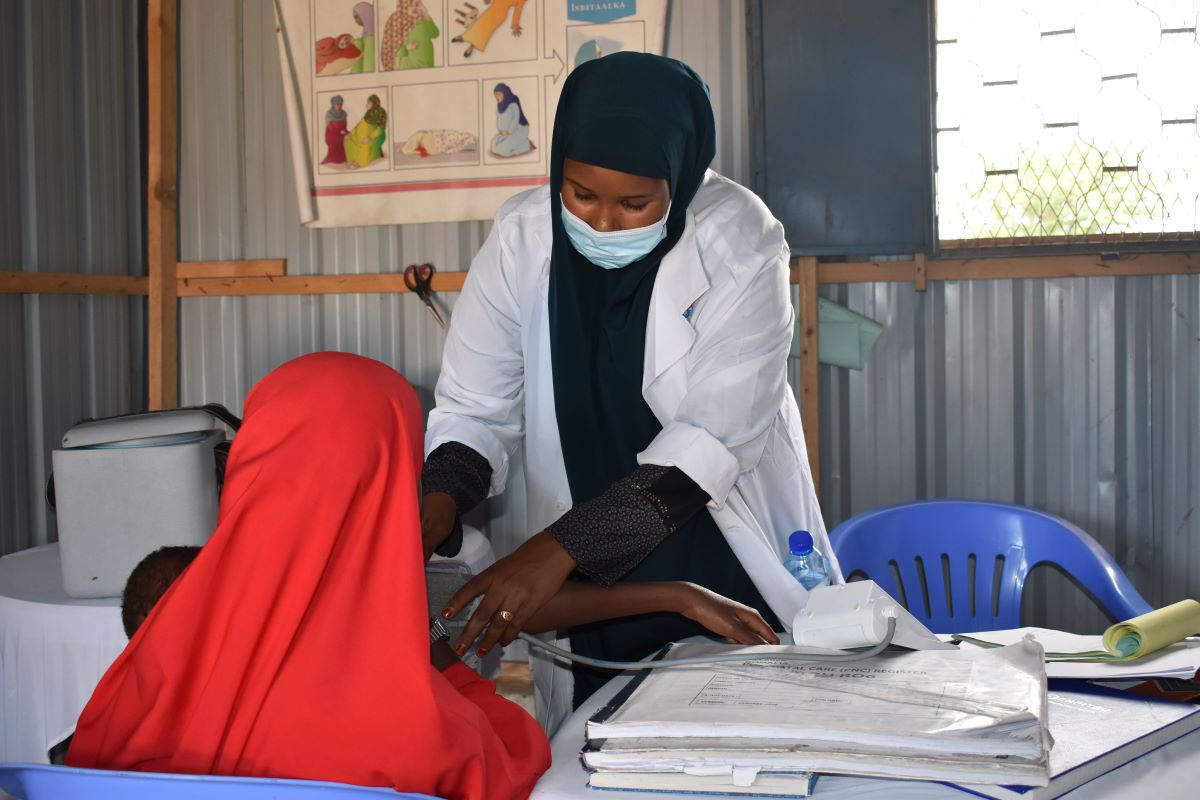 Halima Ahmed Dalel works on a patient