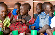Children eating lunch at the Gulu social center