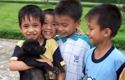 Children play with their dog at an SOS Children's Village